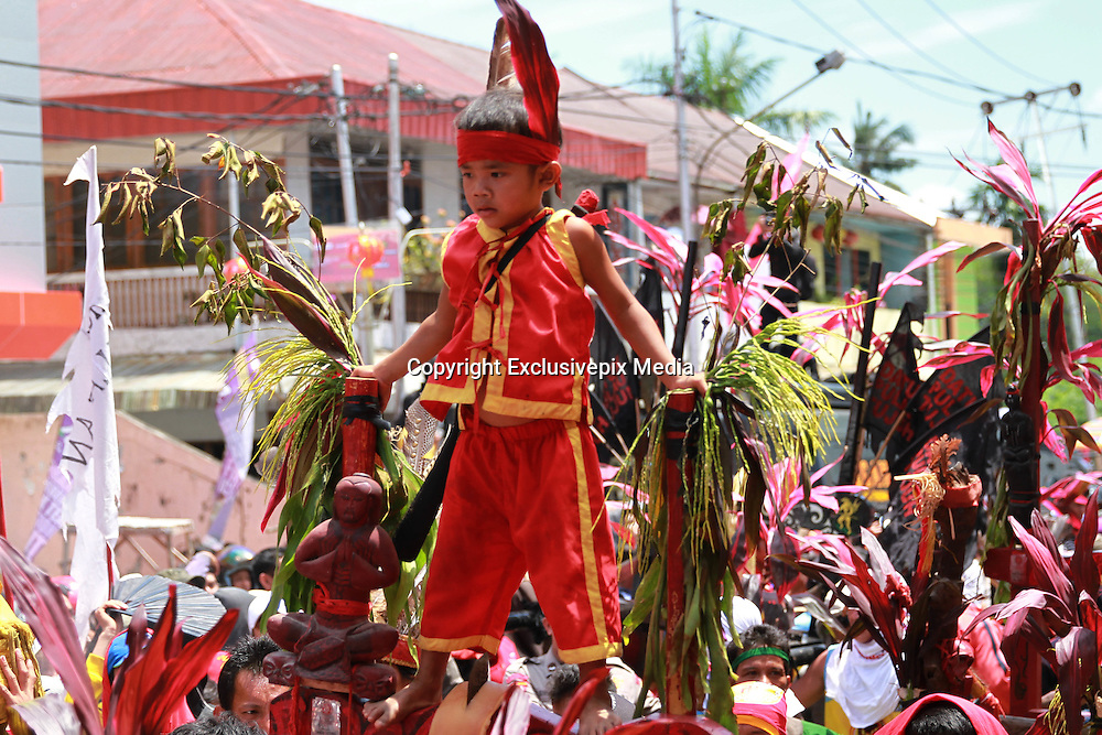 SINGKAWANG, INDONESIA - MARCH 05: <br /> <br /> Cap Go Meh Festivities In Singkawang, Indonesia<br /> <br /> A Tatung pierces metal needles trough his cheeks during Cap Go Meh celebrations on March 5, 2015 in Singkawang, Indonesia. The ancient art of Tatung, performed as part of the Cap Go Meh Festival, is believed to call upon positive spirit who help to dispel the bad spirits that may affect people's lives. Cap Go Meh Festival also know as Lantern Festival is celebrated in the 15th day of Chinese Lunar Year and marks the end of the Chinese New Year celebrations.<br /> ©Exclusivepix Media