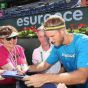 Dominic Inglot signs autographs for fans during the Esurance 'Serve It Up' event at stadium 1 at the Indian Wells Tennis Garden in Indian Wells, California on Tuesday, March 17, 2015.<br /> (Photo by Billie Weiss/BNP Paribas Open)