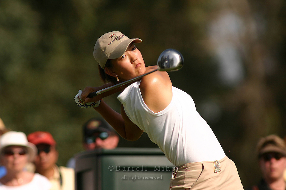 March 25, 2004; Rancho Mirage, CA, USA;  14 year old amateur Michelle Wie tees off at the 16th hole during the 1st round of the LPGA Kraft Nabisco golf tournament held at Mission Hills Country Club.  Wie finished the day tied for 7th with a 3 under par 69.<br />Mandatory Credit: Photo by Darrell Miho <br />&copy; Copyright Darrell Miho