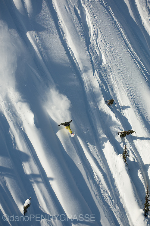 Professional snowboarder Mathieu Crepel turns at extremely high speed near Terrace, British Columbia.