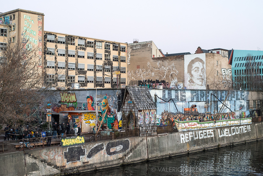 An occupied space in East Berlin, along the Spree River, where people meets for drinks, music, and leftist political talks.