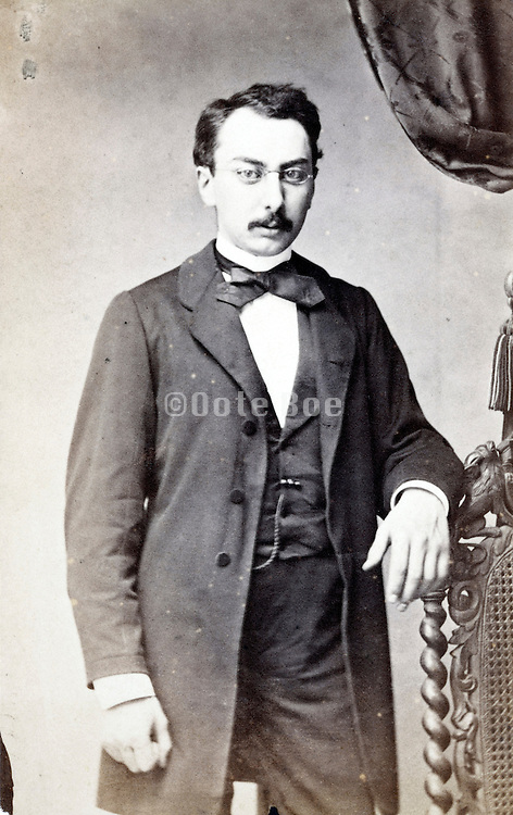 studio portrait man standing late 1800s