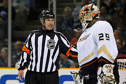 April 2, 2011; San Jose, CA, USA;  NHL referee Stephen Walkom (24) talks to Anaheim Ducks goalie Ray Emery (29) before a face off against the San Jose Sharks during the first period at HP Pavilion. San Jose defeated Anaheim 4-2. Mandatory Credit: Jason O. Watson / US PRESSWIRE
