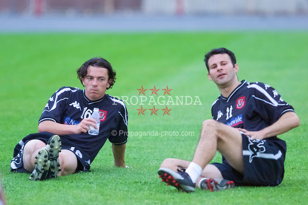 KIEV, UKRAINE - Monday, June 4, 2001: Wales' Simon Davies and Ryan Giggs during training at the Olympiski Stadium in Kiev ahead of his side's World Cup Qualifying match against Ukraine. (Pic by David Rawcliffe/Propaganda)