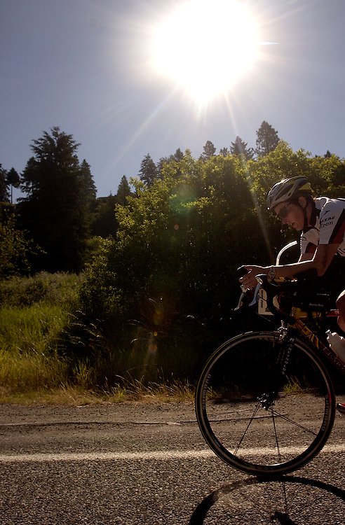 JEROME A. POLLOS/Press..Cam Ray, of Austin Texas, pedals her way along Coeur d'Alene Lake Drive under the late-morning sun. Despite inconsistent weather last week, Sunday's conditions were considered perfect for many Ironman competitors.