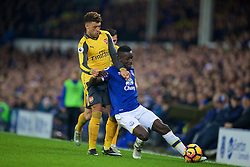 LIVERPOOL, ENGLAND - Tuesday, December 13, 2016: Arsenal's Alex Oxlade-Chamberlain in action against Everton's Enner Valencia during the FA Premier League match at Goodison Park. (Pic by David Rawcliffe/Propaganda)
