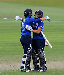 England's Georgia Elwiss and Katherine Brunt celebrate victory by 4 wickets. - Photo mandatory by-line: Harry Trump/JMP - Mobile: 07966 386802 - 21/07/15 - SPORT - CRICKET - Women's Ashes - Royal London ODI - England Women v Australia Women - The County Ground, Taunton, England.