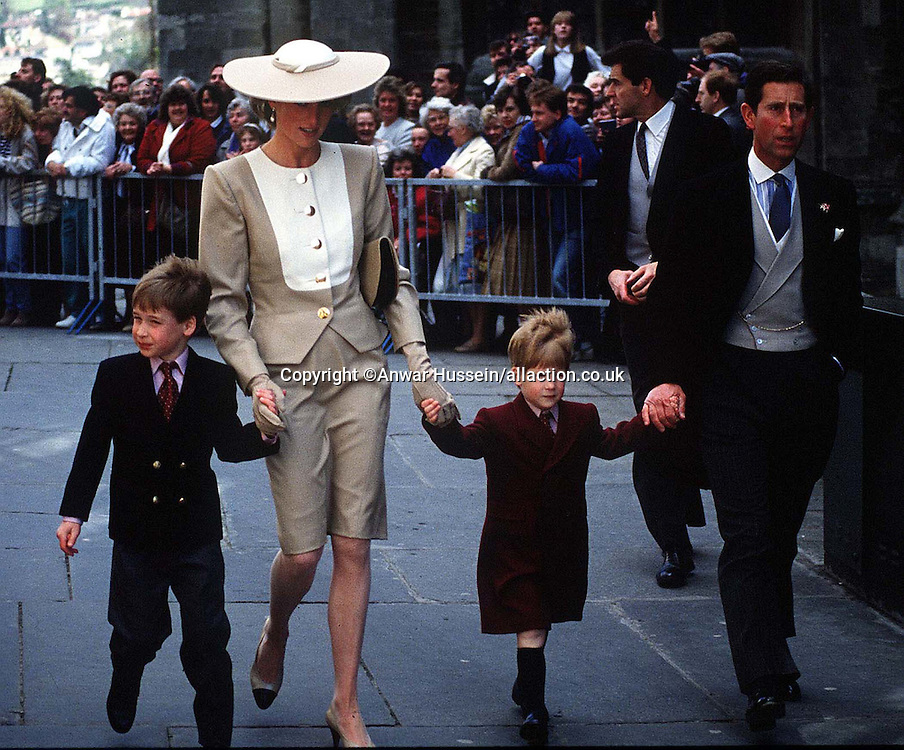 The Prince and Princess of Wales, with young Prince William and Harry at the wedding of Duke Hussey's daughter in Bath, May 1989.<br /><br />Photo.  Anwar Hussein