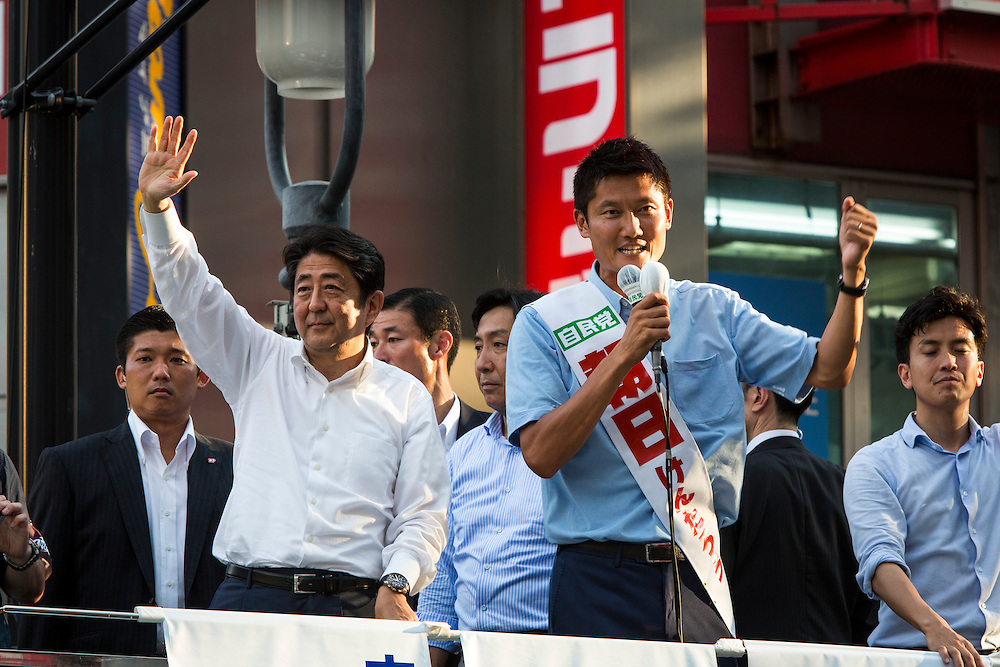 TOKYO, JAPAN - JULY 03 : Kentaro Asahi a candidate of Liberal Democratic Party (LDP), delivers a campaign speech during the Upper House election campaign in Shibuya crossing, Tokyo prefecture, Japan, on July 3, 2016. (Photo by Richard Atrero de Guzman/ANADOLU AGENCY)