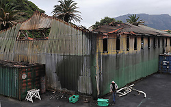 Cape Town - 180813 - The Hout Bay fishing community are distraught and tensions are running high after an alleged poacher was shot at see while being apprehended by the authorities In pic is a torched shed on the harbour  Photographer - Tracey Adams - ANA African News Agency