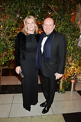 MICHAEL SPENCER and SARAH. MARCHIONESS OF MILFORD HAVEN at the inaugural dinner for The Queen Elizabeth Scholarship Trust hosted by Viscount Linley at the V&A museum, London on 25th February 2016.