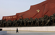 NORTH KOREA: Pyongyang.War Memorial and tribute to the Great Leader.Pyongyang A giant bronze statue of Kim Il Sung dominates a Pyongyang hilltop, surrounded by socialist realistic sculptures.