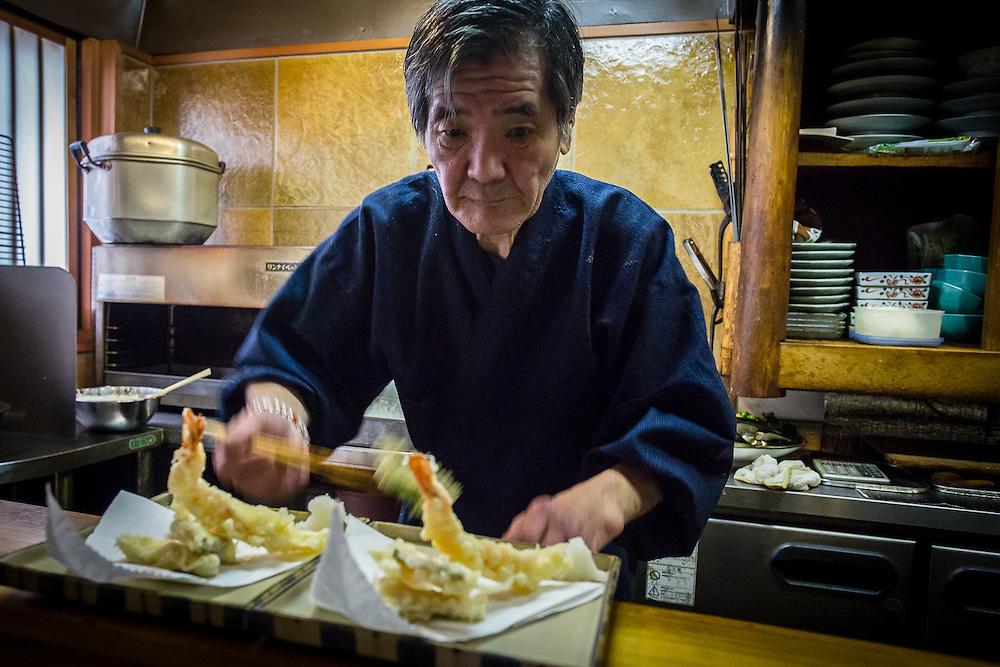 The chef of Takasebune Restaurant prepares Tempura, the restaurant's specialty.
