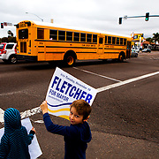 A young Nathan Fletcher supporter campaigns on a corner in Point Loma.