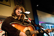Ben Kweller performing at Waterloo Records for the release of his recording, Changing Horses, Austin Texas, February 4, 2009. Ben Kweller (born 1981) is an American rock musician. Waterloo Records is an independent music store in Austin.