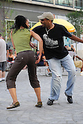 People dancing, partying, and have a good time at Lee Jones's open air Sundae dance party in 2009. This weekly event is held at the the Piazza at Schmidt's in Northern Liberties in Philadelphia each Sunday. This party featured Lady Alma (Alma Horton) and Mark de Clive-Lowe in a live performance.