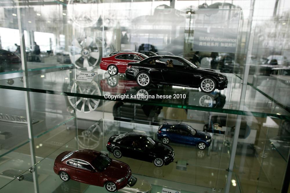 BEIJING, APRIL-22, 2010:   BMW suvenir toys on display  at the BMW dealership .