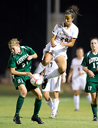 Virginia Cavaliers midfielder/forward Kika Toulouse (20) collides with Loyola Greyhounds midfielder Colleen Kinealy (21).  The #6 Virginia Cavaliers defeated the Loyola College Greyhounds 4-0 in a NCAA Women's Soccer game held at Klockner Stadium on the Grounds of the University of Virginia in Charlottesville, VA on August 22, 2008.