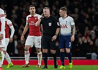Football - 2018 / 2019 EFL Carabao Cup (League Cup) - Quarter-Final: Arsenal vs. Tottenham Hotspur<br /> <br /> Referee Jonathon Moss takes VAR advice on the Tottenham goal at The Emirates.<br /> <br /> COLORSPORT/DANIEL BEARHAM