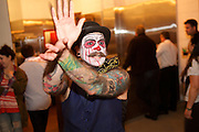 Brooklyn, NY - October 8, 2014: Burlesque performer calls for attention at the opening for Arrogant Swine, a Carolina-style Barbecue restaurant in Bushwick.<br /> <br /> CREDIT: Clay Williams for Arrogant Swine.<br /> <br /> &copy; Clay Williams / claywilliamsphoto.com