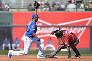 SURPRISE, AZ - MARCH 06:  Alcides Escobar #2 of the Kansas City Royals tags out Domingo Leyba #74 of the Arizona Diamondbacks after attempting to steal third base during the third inning of the spring training game at Surprise Stadium on March 6, 2017 in Surprise, Arizona.  (Photo by Jennifer Stewart/Getty Images)