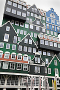 typical Dutch houses facades in the Zaanstreek area are used for the new Inntel Hotel in Zaandam, Netherlands.