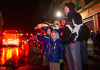 Excitement builds as young and old line Main Street awaiting Santa's arrival during the Holiday Parade on Saturday evening.  (Karen Bobotas/for the Laconia Daily Sun)