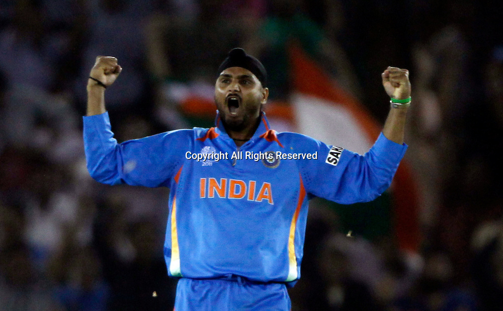 30.03.2011 Cricket World Cup from the Punjab Cricket Association Stadium, Mohali in Chandigarh. India v Pakistan. Harbhjan Singh of India celebrates the wicket of Shahid Afridi during the match of the ICC Cricket World Cup between India and Pakistan on the 30th March 2011