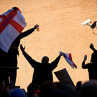 Members of the English Defence League (EDL) assemble outside a the Jazz Pub in Preston, England before protesting on November 27, 2010. Approximately 1,000 protestors assembled for the rally.  Numerous arrests were made in Preston's largest ever policing operation.  Counter-protest demonstrations by Unite Against Facism (UAF) took place nearby.