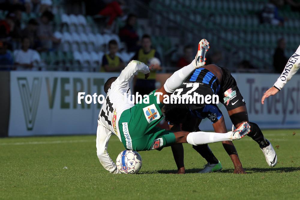 13.9.2014, Veritas Stadion, Turku.<br /> Veikkausliiga 2014.<br /> FC Inter Turku - IFK Mariehamn.<br /> David Ramadingaye (IFK Mhamn) v Vincent Onovo (Inter).