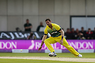 James Pattinson of Australia fields his own bowling during the 3rd One Day International match at Old Trafford Cricket Ground, Stretford<br /> Picture by Andy Kearns/Focus Images Ltd 0781 864 4264<br /> 08/09/2015