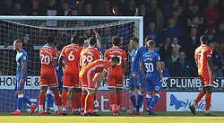 Ivan Toney of Peterborough United (hidden) is shown a straight red card after denying Shrewsbury Town a goal by handling the ball - Mandatory by-line: Joe Dent/JMP - 23/02/2019 - FOOTBALL - ABAX Stadium - Peterborough, England - Peterborough United v Shrewsbury Town - Sky Bet League One
