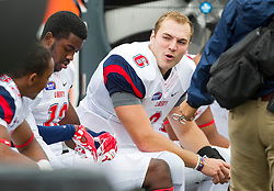 Sep 12, 2015; Morgantown, WV, USA; Liberty Flames quarterback Josh Woodrum talks to teammates on the sidelines during the second quarter at Milan Puskar Stadium. Mandatory Credit: Ben Queen-USA TODAY Sports