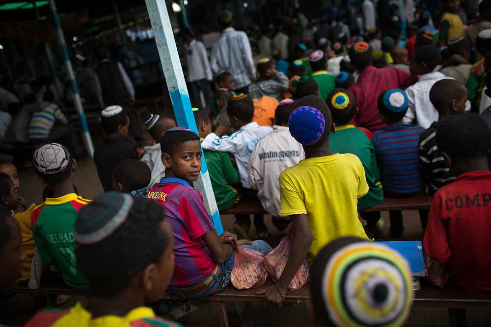 Young boys of the Falash Mura Jewish Ethiopian community wait for prayer service in the haTikva synagogue in Gonder, Ethiopia. There are about 6000 Jewish Falash Mura in Gonder, waiting to immigrate to Israel. April 22, 2016. Photo by Miriam Alster/FLASH90