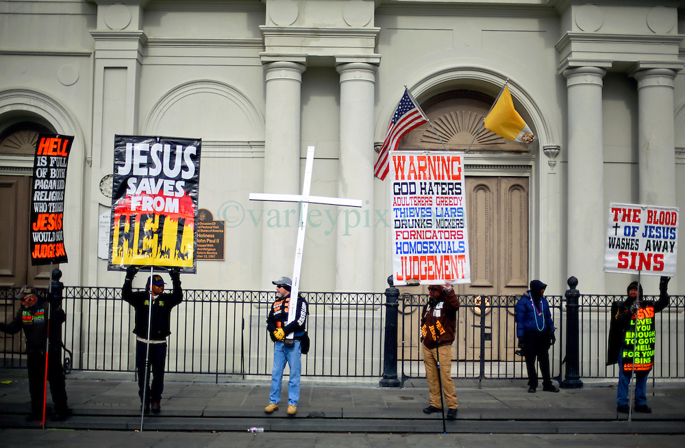 17 Feb 2015. New Orleans, Louisiana.<br /> Fat Tuesday. Mardi Gras Day. Christian fundamentalists stake out their turf in front of Saint Louis Cathedral early in the morning.<br /> Photo; Charlie Varley/varleypix.com