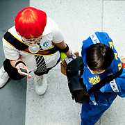 Teenagers dressed in character stand inside the Busan Exhibition and Convention Center during Comic World, a bi-monthly comic convention in Busan, South Korea, May 5, 2012.