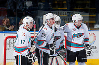 KELOWNA, CANADA - JANUARY 22: Rodney Southam #17, Cal Foote #25, Lucas Johansen #7 and Michael Herringer #30 of Kelowna Rockets celebrate the win against the Tri City Americans on January 22, 2016 at Prospera Place in Kelowna, British Columbia, Canada.  (Photo by Marissa Baecker/Shoot the Breeze)  *** Local Caption *** Rodney Southam; Lucas Johansen; Michael Herringer; Cal Foote;