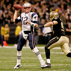 2009 November 30:  New Orleans Saints defensive end Jeff Charleston (97) pressures New England Patriots quarterback Tom Brady (12) to throw during the second half at the Louisiana Superdome in New Orleans, Louisiana.