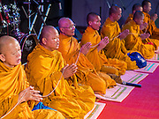 27 JULY 2013 - BANGKOK, THAILAND: Buddhist monks at a merit making ceremony to honor Thaksin Shinawatra at a birthday party for Thaksin. The Red Shirts celebrated former Prime Minister Thaksin Shinawatra's 64th birthday with a party at Phibun Prachasan School in Bangkok. They had a Buddhist Merit Making Ceremony, dinner, cake and entertainment. Most of the Red Shirt political elite traveled to Hong Kong for a party with Thaksin. Thaksin, the former Prime Minister, was deposed by a coup in 2006 and subsequently convicted of corruption related crimes. He went into exile rather than go to jail but remains very popular in rural parts of Thailand. His sister, Yingluck Shinawatra is the current Prime Minister and was elected based on her brother's recommendation.     PHOTO BY JACK KURTZ