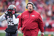 LITTLE ROCK, ARKANSAS - NOVEMBER 23:  Head Coach Bret Bielema of the Arkansas Razorbacks on the sidelines during a game against the Mississippi State Bulldogs at War Memorial Stadium on November 23, 2013 in Little Rock, Arkansas.  The Bulldogs defeated the Razorbacks 24-17.  (Photo by Wesley Hitt/Getty Images) *** Local Caption *** Bret Bielema