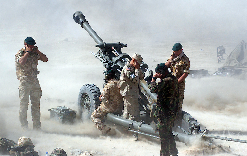 British and American forces fire 105mm artillery rounds during a live fire exercise June 11, 2002 at Bagram Airbase in Afghanistan. Coalition troops continue to train for missions in Afghanistan as part of Operation Enduring Freedom.