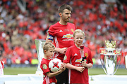 Manchester United 08 XI Michael Carrick and his son and daughter during the Michael Carrick Testimonial Match between Manchester United 2008 XI and Michael Carrick All-Star XI at Old Trafford, Manchester, England on 4 June 2017. Photo by Phil Duncan.