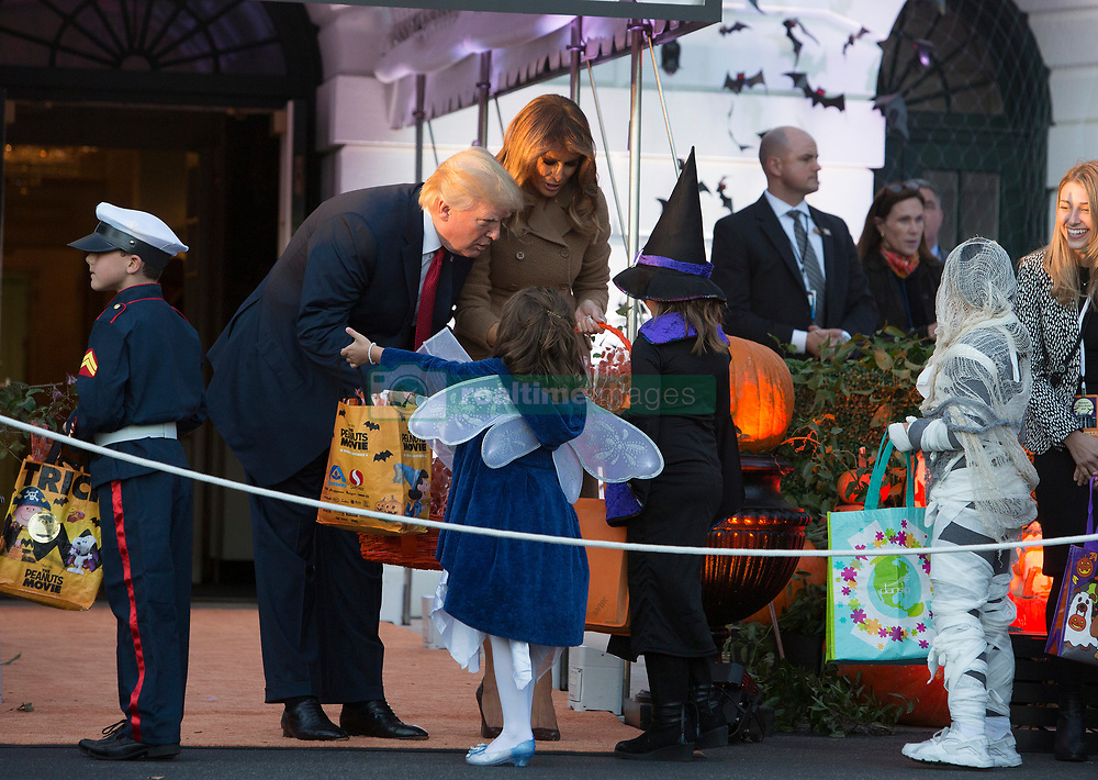 United States President Donald J. Trump and First Lady Melania Trump give out treats during a Halloween event at The White House in Washington, DC, October 30, 2017. 30 Oct 2017 Pictured: United States President Donald J. Trump and First Lady Melania Trump give out treats during a Halloween event at The White House in Washington, DC, October 30, 2017. Credit: Chris Kleponis / CNP. Photo credit: Chris Kleponis - CNP / MEGA TheMegaAgency.com +1 888 505 6342
