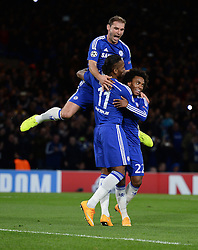 Chelsea's Branislav Ivanovic jumps on Chelsea's Didier Drogba to celebrate his goal. - Photo mandatory by-line: Alex James/JMP - Mobile: 07966 386802 - 21/10/2014 - SPORT - Football - London - Stamford Bridge - Chelsea v NK Maribor - Champions League