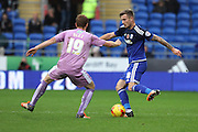 Cardiff City midfielder Joe Ralls and Reading midfielder Alex Fernandez during the Sky Bet Championship match between Cardiff City and Reading at the Cardiff City Stadium, Cardiff, Wales on 7 November 2015. Photo by Jemma Phillips.