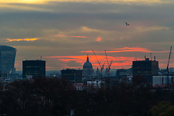 London, November 30 2017. St Paul's Cathedral is seen in silhouette as the sun rises over the London skyline, seen from Primrose Hill, on a chilly London morning when overnight temperatures plunged to below freezing. © Paul Davey