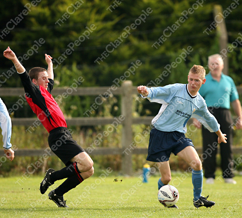 Bridge Utd.'sJonathan Hayes tries to stop the advances of Turnpike's Dean Lee during their cup final clash in the County Grounds on Sunday morning.<br />