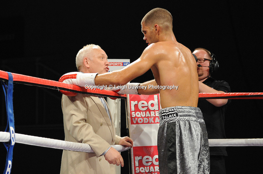 Frank Maloney congratulates Tony Hill over his win against Paul Samuels at Medway Park, Gillingham, Kent, UK on 13th May 2011. Frank Maloney Promotions. Photo credit © Leigh Dawney 2011.