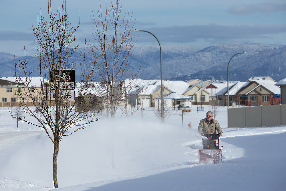 GABE GREEN/Press<br /> <br /> Post Falls resident Harry Rogers walks his snowblower along Bogie Drive, clearing snow from the sidewalk Saturday.