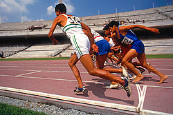 Group of male athletes at start of running track, Mexico
